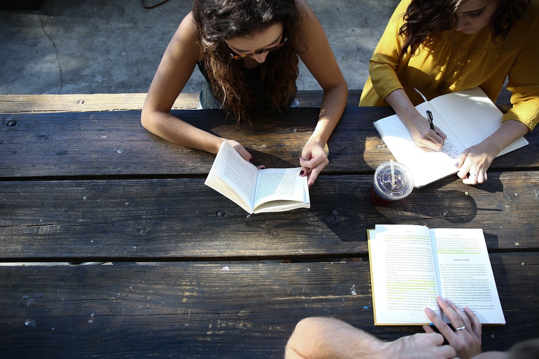 3 girls are studying together