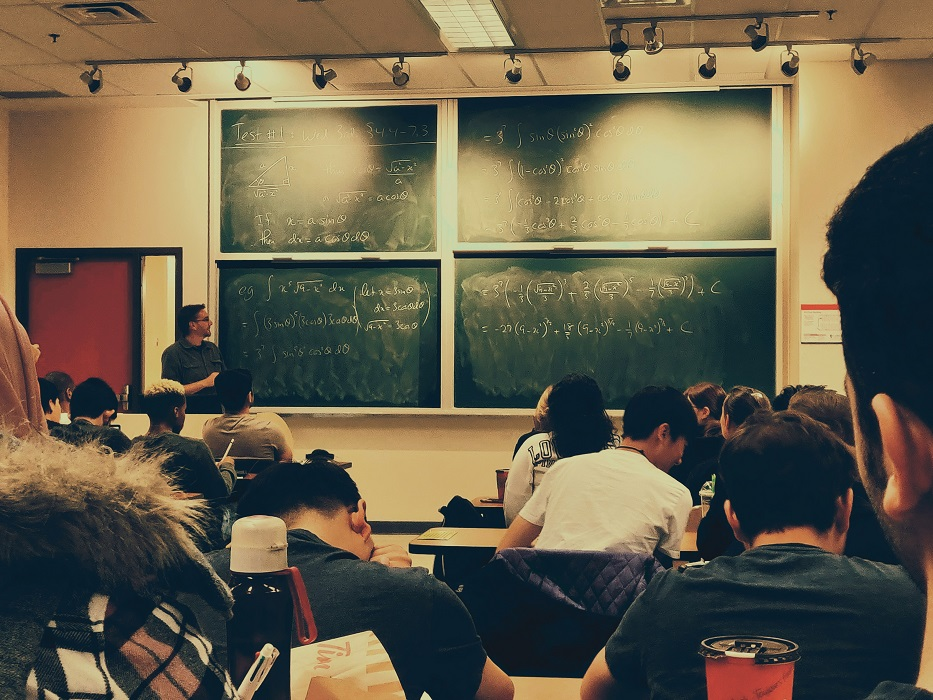 Professor is teaching a class full of students